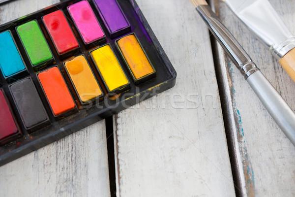 Színes paletta festőecsetek fából készült felület fa Stock fotó © wavebreak_media