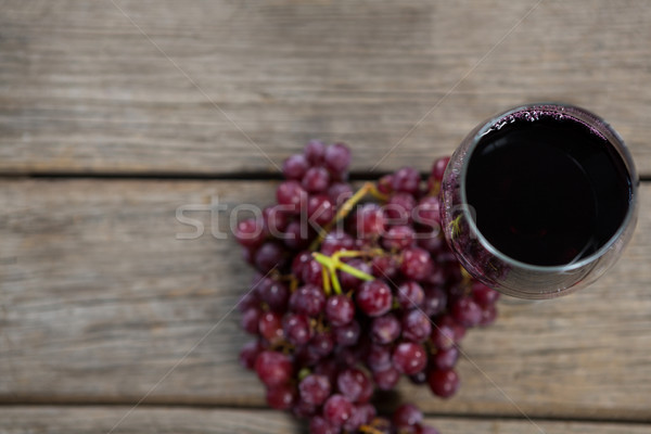 Overhead of red bunch of grapes with glass of red wine Stock photo © wavebreak_media