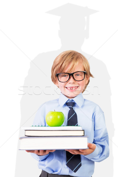 Composite image of cute pupil holding books and apple Stock photo © wavebreak_media