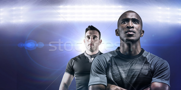 Composite image of thoughtful athlete standing with arms crossed Stock photo © wavebreak_media