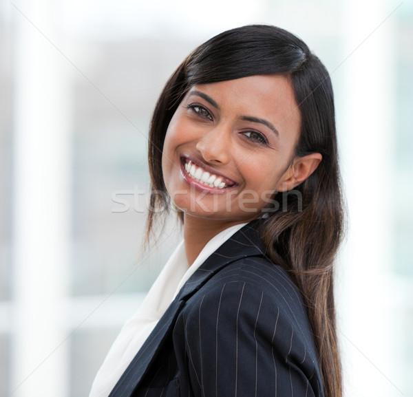 Portrait of a radiant businesswoman standing  Stock photo © wavebreak_media
