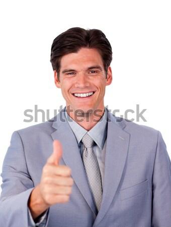 Fortunate businessman with thumb up  Stock photo © wavebreak_media
