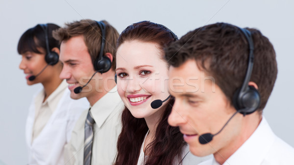 Smiling woman working in a call center with her colleagues Stock photo © wavebreak_media
