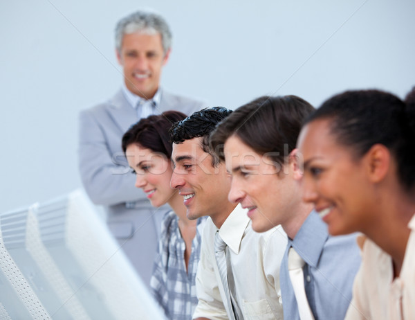 Positive business people with their senior manager  Stock photo © wavebreak_media