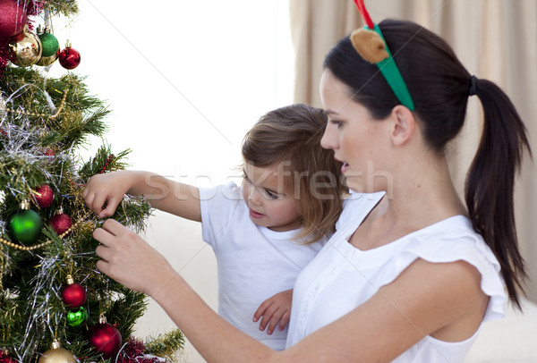 Mother and daughter decorating a Christmas tree Stock photo © wavebreak_media