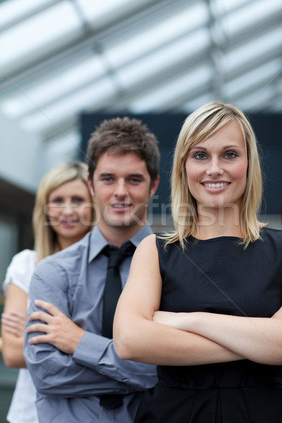 Beautiful businesswoman leading her team with folded arms Stock photo © wavebreak_media
