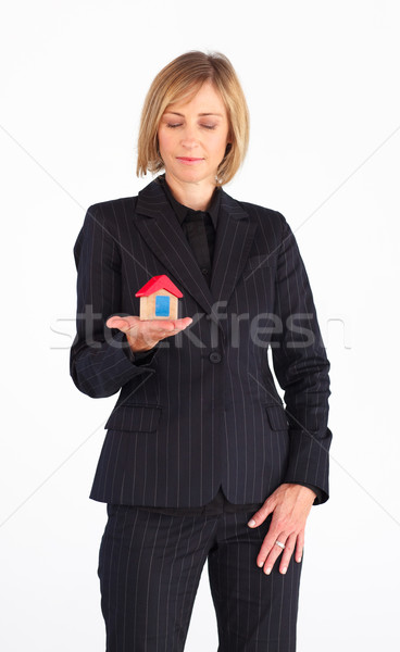 Real state agent holding a house Stock photo © wavebreak_media
