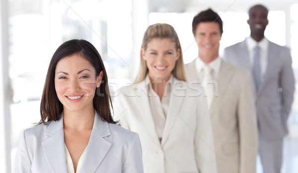 Quattro persone guardando fotocamera sorridere mani Foto d'archivio © wavebreak_media