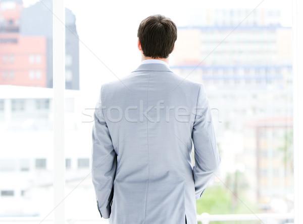 Ambitieus zakenman naar venster kantoor gelukkig Stockfoto © wavebreak_media