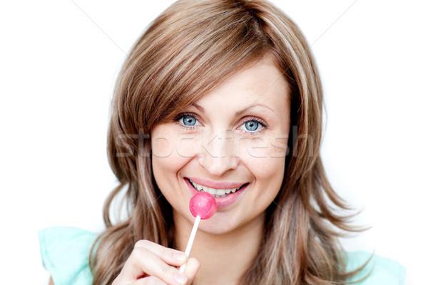 Attractive woman holding a lollipop  Stock photo © wavebreak_media