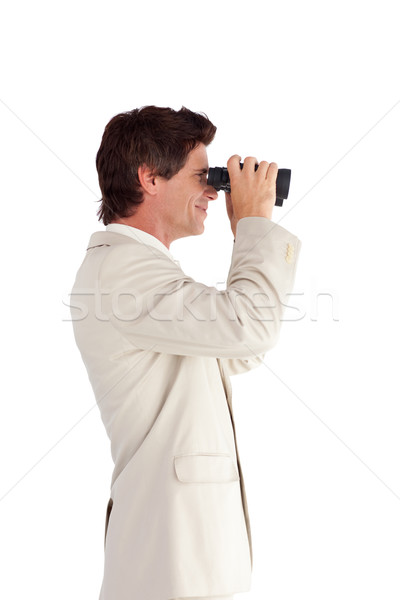 Self-assured businessman with binoculars isolated against white background  Stock photo © wavebreak_media