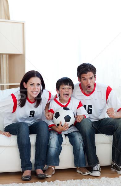Família assistindo futebol combinar casa homem Foto stock © wavebreak_media