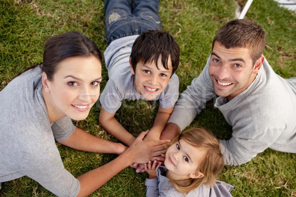 Jeunes parents Kid jardin mains ensemble Photo stock © wavebreak_media