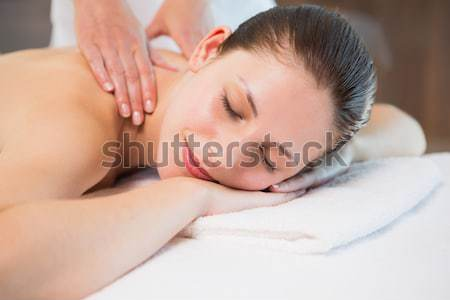 Attractive woman having a massage with massage oil in a spa  Stock photo © wavebreak_media