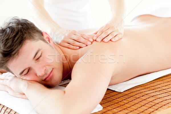 Charyzmatyczny człowiek powrót masażu Zdjęcia stock © wavebreak_media