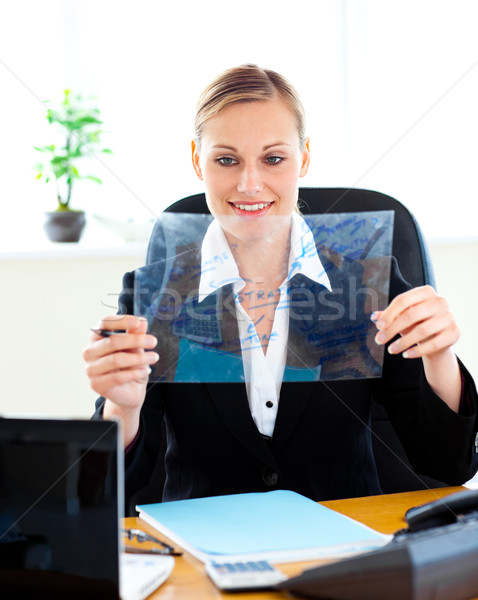 Confident businesswoman preparing slides for a presentation in her office Stock photo © wavebreak_media
