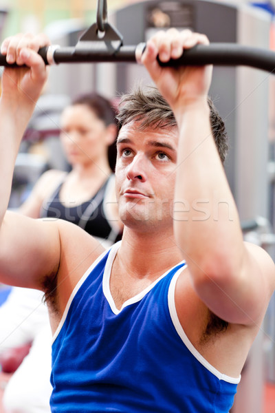 Male athlete practicing body-building in a fitness center Stock photo © wavebreak_media
