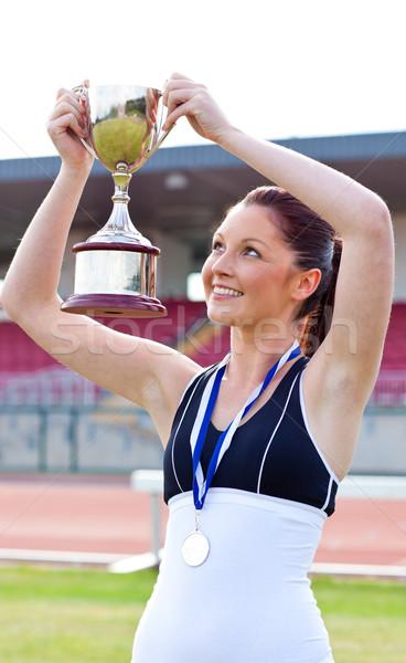 Blijde vrouwelijke atleet medaille stadion Stockfoto © wavebreak_media