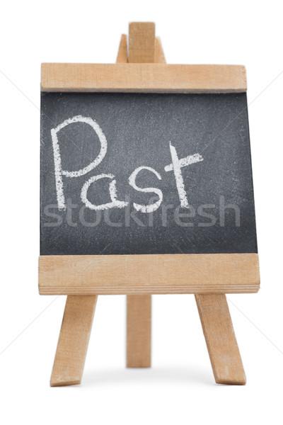 Kara tahta kelime geçmiş yazılı yalıtılmış beyaz Stok fotoğraf © wavebreak_media