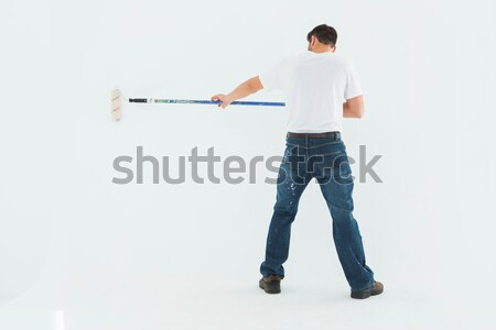 Handsome man showing a copy space against a white background Stock photo © wavebreak_media