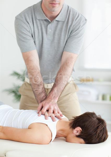 Jóképű férfi üzenetküldés aranyos nyak szoba kéz Stock fotó © wavebreak_media