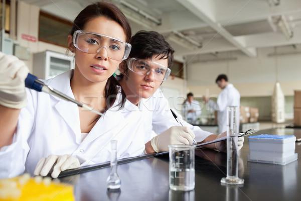 Fiatal tudomány diákok dolgozik laboratórium mosoly Stock fotó © wavebreak_media