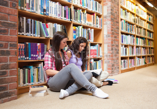 Femminile studenti libro biblioteca donna mano Foto d'archivio © wavebreak_media
