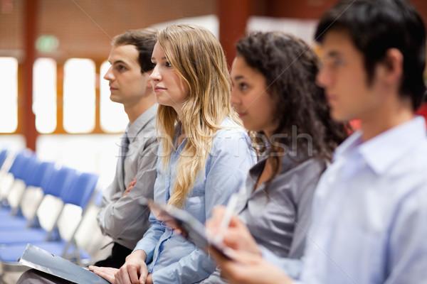 Pessoas de negócios escuta apresentação negócio papel Foto stock © wavebreak_media