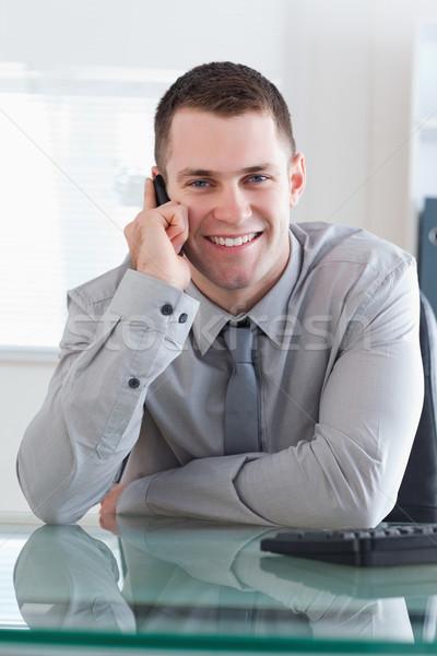 Businessman getting a pleasant call on his cellphone Stock photo © wavebreak_media