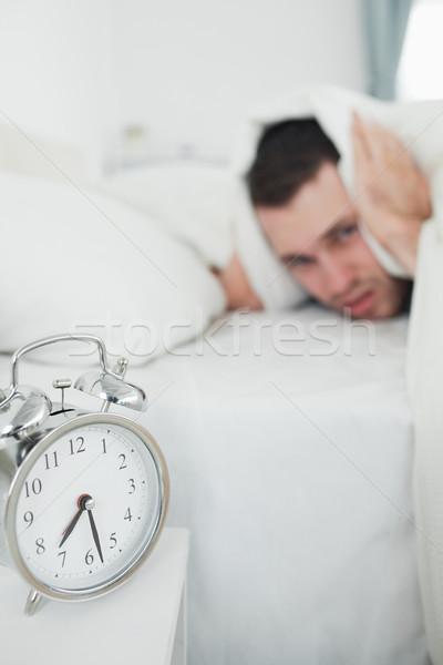 Retrato moço orelhas despertador mão relógio Foto stock © wavebreak_media