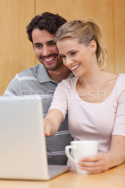 Portrait of a couple using a notebook while having tea in their kitchen Stock photo © wavebreak_media