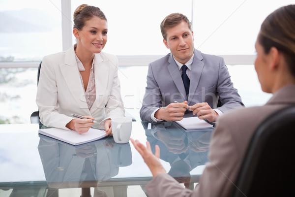 üzletemberek tárgyalás papír munka dolgozik beszél Stock fotó © wavebreak_media