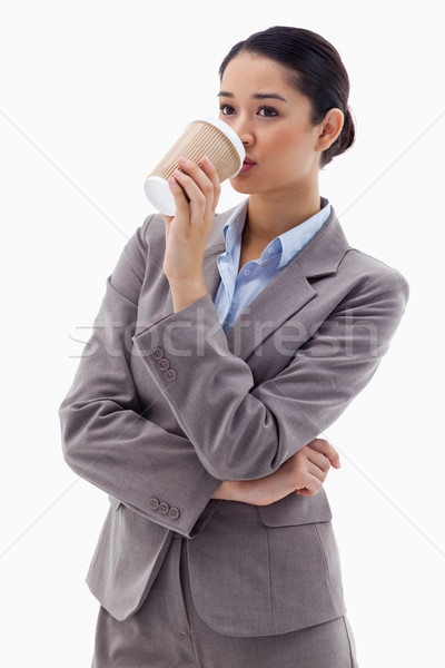 Portrait of a businesswoman drinking a takeaway tea against a white background Stock photo © wavebreak_media