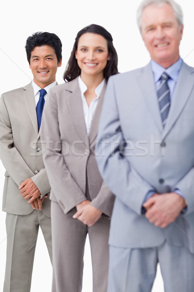 Young salespeople together with mentor against a white background Stock photo © wavebreak_media
