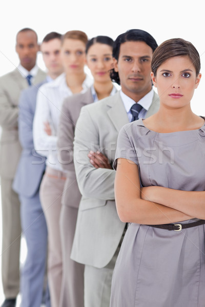 Close-up of serious workmates crossing their arms in a single line with focus on the first woman Stock photo © wavebreak_media
