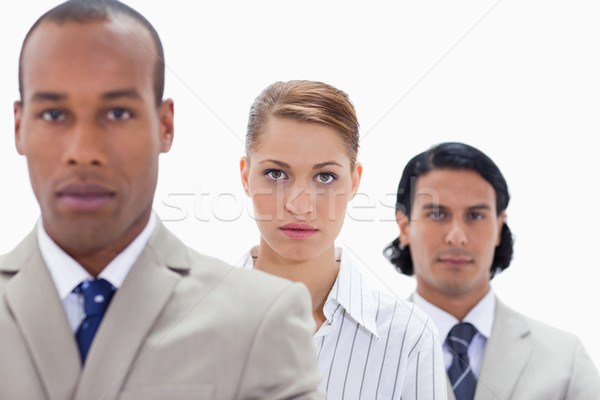 Big close-up of a serious business team in a single line with focus on the woman Stock photo © wavebreak_media