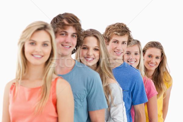 Foto d'archivio: Sorridere · gruppo · piedi · dietro · altro · guardando