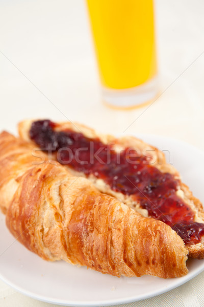 Glass of orange juice behind a croissant Stock photo © wavebreak_media