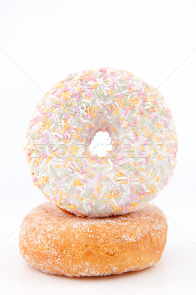 Doughnut with multi coloured icing sugar against a white back ground Stock photo © wavebreak_media