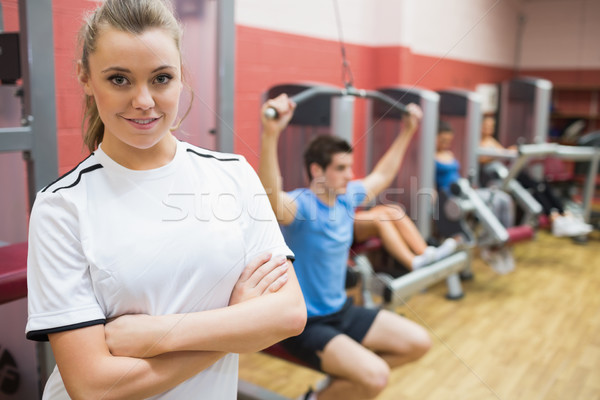 Woman with arms crossed standing in a fitness studio in gym Stock photo © wavebreak_media