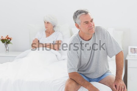 Doctor caring about elderly lady in hospital bed Stock photo © wavebreak_media