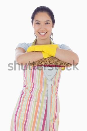 Donna sorridente indossare guanti grembiule felice Foto d'archivio © wavebreak_media