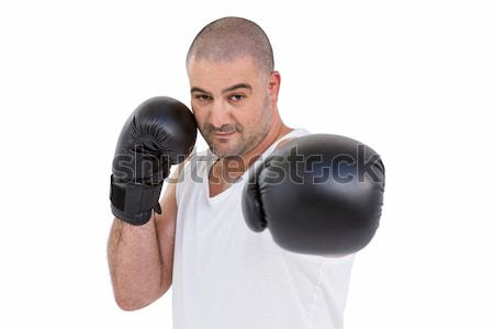 Portrait of young male boxer punching Stock photo © wavebreak_media