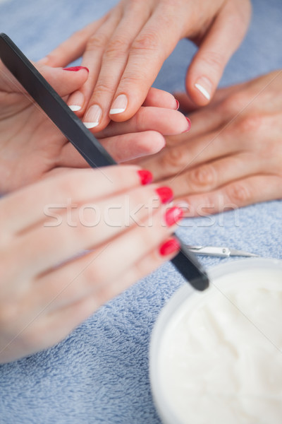Close-up of woman filing fingernail Stock photo © wavebreak_media