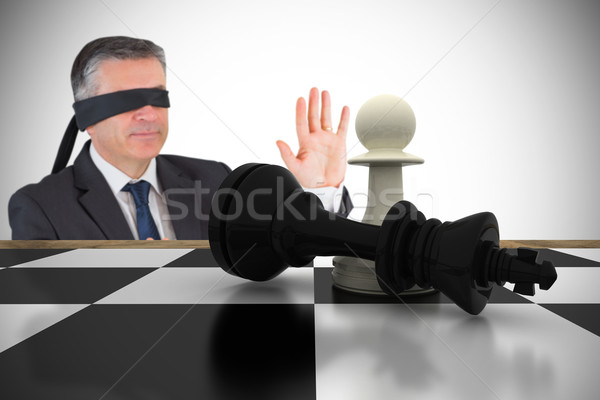 Composite image of mature businessman in a blindfold Stock photo © wavebreak_media