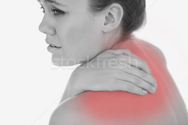 Upset woman suffering from backache Stock photo © wavebreak_media