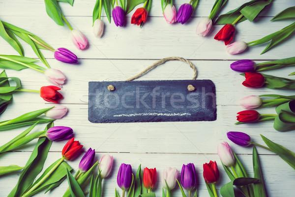 Tulpen frame rond schoolbord houten tafel tabel Stockfoto © wavebreak_media