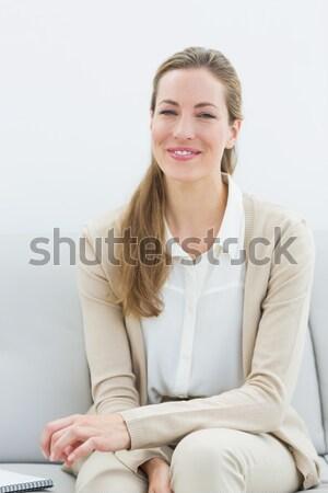 Smiling psychologist sitting on sofa Stock photo © wavebreak_media