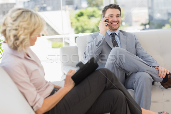 бизнесмен вызова секретарь дневнике домой сидят Сток-фото © wavebreak_media