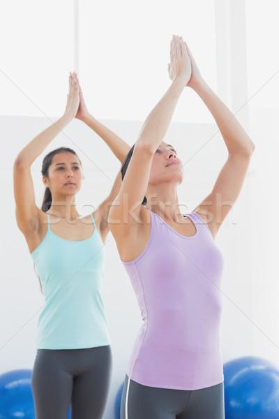 Women with joined hands in fitness studio Stock photo © wavebreak_media